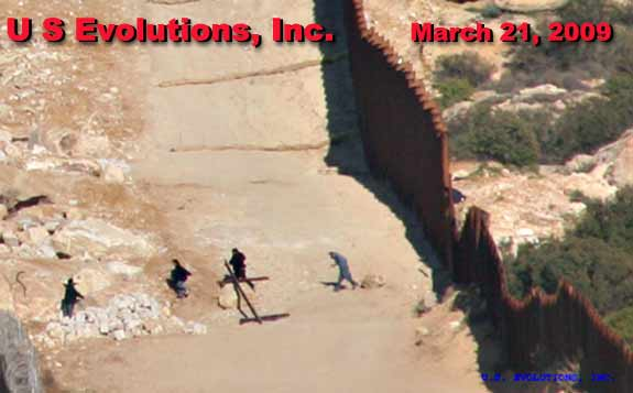 illegal aliens crossing border fence